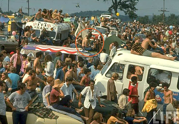 Bob stitting atop the bus at Woodstock